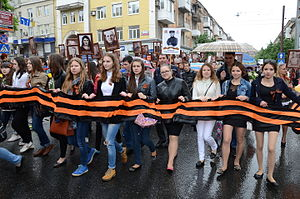 Ribbon of Saint George - Local residents in Donetsk carry portraits of their ancestors and participants in World War II, 9 May 2015