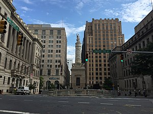 St. Paul Street-Calvert Street - Looking north towards the Battle Monument of 1815-1822 from the War of 1812, symbol of Baltimore on the city seal and flag on North Calvert Street, between East Fayette and Lexington Streets flanked by two municipal courthouses