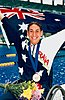 Australian disabled swimmer Priya Cooper holding the Australian flag after winning gold at the 1996 Summer Paralympics