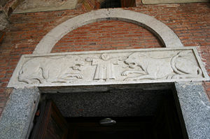 Architrave - Architrave of the left-side portal in the facade of Sant'Ambrogio basilica in Milan, Italy