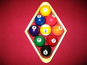 Rack (billiards) - A diamond-shaped wooden nine-ball rack, racker's view: 1 ball in front, 9 ball centered.