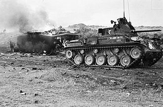 Firebase Gio Linh - An LVT-5 hit by mortars at Firebase Gio Linh on the night of 9 May 1967 still burns the next morning