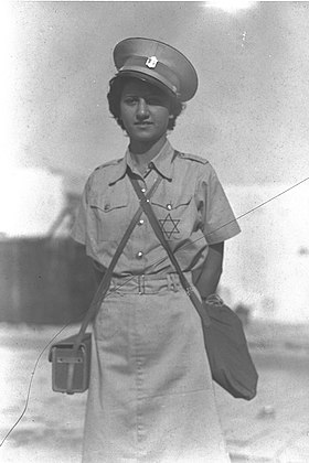 A Magen David Adom worker in the Tel Aviv civil defense, 1939 A MAGEN DAVID ADOM WORKER IN THE TEL AVIV CIVIL DEFENSE. mtndbt SHl mgn dvd Advm bmSHmr hAzrKHy.D23-016.jpg
