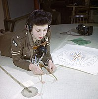 A member of the Auxiliary Territorial Service, Miss Elizabeth Amery, computes the range at 428 Battery, Coastal Defence Artillery Headquarters, Dover, December 1942. TR561.jpg