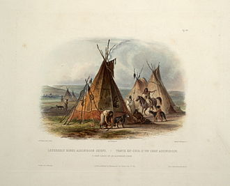 Iron Confederacy - A print of a Karl Bodmer painting published in London, UK in 1840.  It shows an Assiniboine camp with tipis, travois and horses.