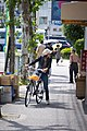 A woman with bicycle in Kyoto.jpg