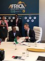 Adam Boehler and Akinwumi Adesina signing a MOU.jpg