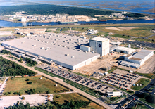 The NASA Michoud Rocket Factory Complex from a helicopter at 1700 feet. c 1990. The North VAB (top left of large building) was not constructed until 2011. Across the canal is a steel mill iron ore processing facility.