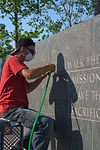 An engraver working on the memorial.