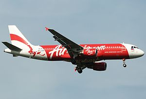 Philippines AirAsia - An Airbus A320-200 of AirAsia Philippines over Singapore Changi Airport.