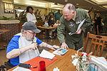 Airmen, school children serenade residents 141209-Z-AL508-018.jpg