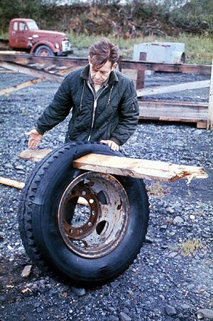 1964 Alaska earthquake - A plank driven through a tire by the tsunami in Whittier