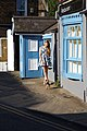 Albion Street blue door and windows and woman with Yorkshire Terrier at Broadstairs Kent England 1.jpg