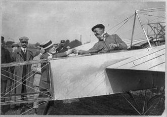 Henri Deutsch de la Meurthe - Alfred Leblanc in airplane, being congratulated by Deutsch de la Meurthe, in Nancy, France after the Circuit de l'Est d'Aviation