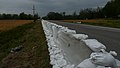 An 880-foot cement floodwater barrier placed by U.S. Soldiers with the 1140th Engineer Battalion, Missouri Army National Guard can be seen along Highway 74 in Dutchtown, Mo., April 24, 2013 130424-Z-XO647-001.jpg