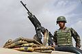 An Afghan National Army commando with the 1st Tolai, 3rd Special Operations Kandak stands behind an M240B machine gun during a training exercise in the Dand district, Kandahar province, Afghanistan, May 25 130525-A-QS703-031.jpg