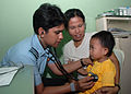 An Indian physician examines boy on Gunungsitoli.jpg