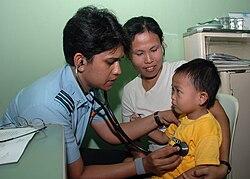 An Indian physician examines boy on Gunungsitoli.jpg