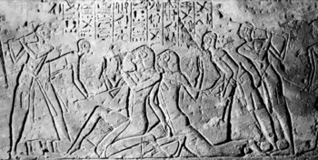 Ancient carving - Shasu spies being beaten by Egyptians