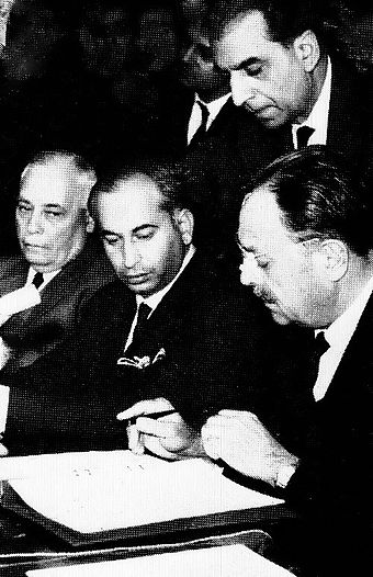 Signing of the Tashkent Declaration to end hostilities with India in 1965 in Tashkent, USSR, by President Ayub alongside Bhutto (centre) and Aziz Ahmed (left) Ayubkhanandbhutto.jpg