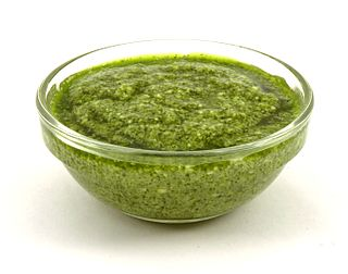 Pesto sauce made from basil, pine nuts, Parmigiano Reggiano, olive oil, and garlic