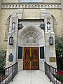Basilica of the Sacred Heart (Notre Dame, Indiana) - exterior, east portal, memorial to Notre Dame students killed in WWI.jpg