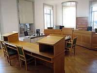 A small courtroom in the Supreme Court of the ...