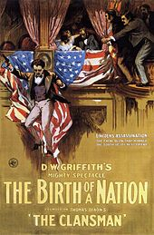 The theatrical poster for The Birth of a Nation depicting a hooded man carrying a burning cross on horse back.