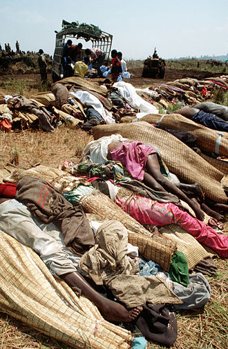 Great Lakes refugee crisis - Bodies of Rwandan refugees wrapped in blankets and straw mats along a road, October 1994