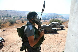 Israel Border Police - A Border Policeman in a tear gas mask