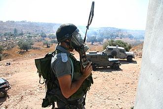 Israel Border Police - A Border Policeman in a tear gas mask