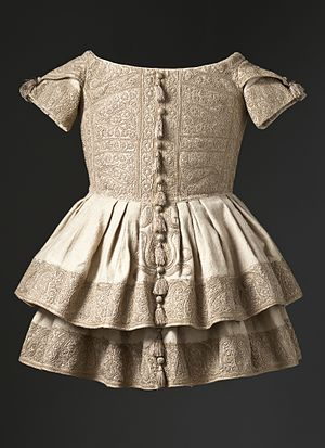 Cashmere wool - A boy's frock produced circa 1855 in Kashmir; cashmere wool twill with silk embroidery and silk tassels.
