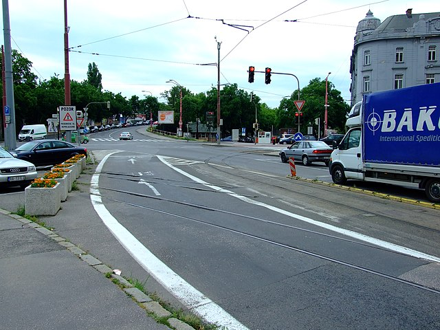 A solid white line at Šafárikovo námestie square in Bratislava near Starý most bridge.