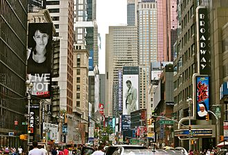 Sean Combs - A billboard of Sean John is in the distance on Broadway