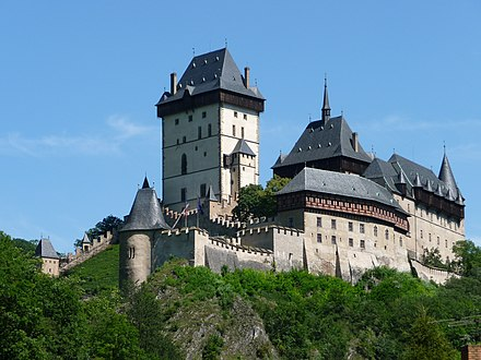 Medieval castles such as Karlstejn are frequent tourist attractions. Burg Karlstein - Karlstejn - panoramio.jpg