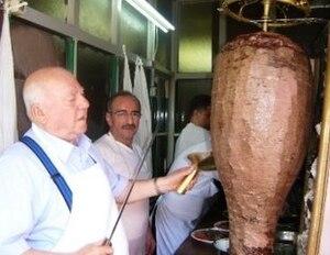 Rotisserie - A vertical rotisserie cooking Döner kebab
