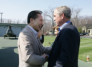 Lee Myung-bak - Lee shakes hands with United States President George W. Bush upon his arrival at Camp David, Maryland, United States, 18 April 2008