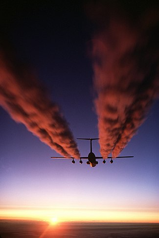 A C-141 Starlifter leaves vapour trails over Antarctica