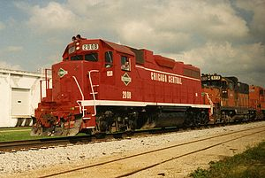 Chicago Central - A Chicago Central train passes westbound through northern Illinois in 1993.