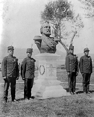 Banda Islands - Colonial soldiers standing guard next to the statue of King Willem III of the Netherlands, representing Dutch dominance on Banda.