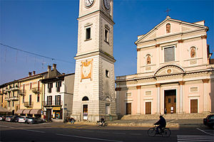 Cameri - Piazza Dante with the church of San Michele and bell-tower.