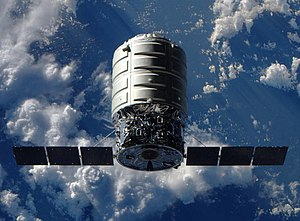 Commercial Orbital Transportation Services - Image: Canadarm 2 reaches out to Cygnus 1 crop
