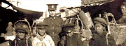 Canadian Pte Edwin Stephenson poses with boys in Vladivostok in 1919