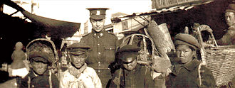 Siberian Intervention - Canadian soldier poses with boys in Vladivostok