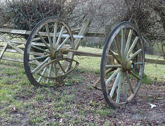 Dropped axle - Cart wheels with dropped axle.  Note that the weight of the springs has turned the axle upside down.