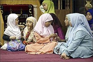 Malayisation - Cham girls, wearing Baju Kurung.