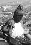Charred Buddha statue detail, Nagasaki temple destroyed (cropped).jpg