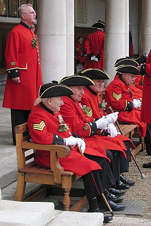 Chelsea Pensioner - Chelsea pensioners in scarlet coats and tricorne hats at the Founder's Day parade in the Royal Hospital Chelsea
