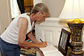 Cheryl Wankum, mother of honorary Marine Daran Wankum, not shown, signs a guest book at the Home of the Commandants at Marine Barracks Washington in Washington, D.C., June 13, 2013 130613-M-KS211-065.jpg