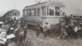 Children play around two St. John's streecars -a.webp